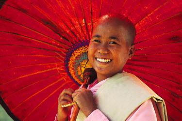 HMS0235841 Myanmar (Burma), Sagaing Division, Mingun, Paya Hsinbyume Pagoda, portrait of a Buddhist nun with an umbrella
