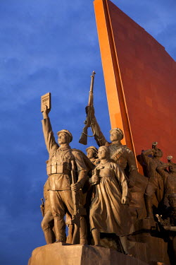 NKO0102 North Korea, Pyongyang. The Socialist Revolution monument consisting of the DPRK and KWP flags rendered in stone and lined with 228 bronze figures, forming part of the Mansudae Grand Monument on Mansu...