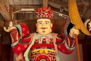 NKO0175 North Korea, Myohyang. A guardian of the Buddha at Pohyon Temple, located on the slopes of the Myohyang mountains. Pohyon was founded in 1042 by the monk Kwanghwak although much was destoyed during th...