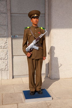 NKO0185 North Korea, Myohyang. Guard at the entrance to Kim Il Sung's International Friendship Exhibition building, dedicated to the world's gifts for the Great Leader and kept in cavernous halls burrowed dee...