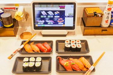 TPX52743 Japan, Honshu, Tokyo, Sushi Restaurant, Touch Screen Conveyor Belt Ordering System