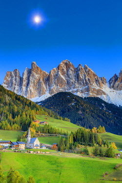 IT04415 Italy, Trentino Alto Adige, South Tyrol Region, Night view of Val di Funes and Santa Magdalena town with Puez Odle Dolomites Group (Puez Geisler) in the Background