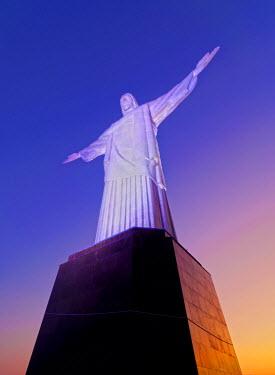BRA2688AW Brazil, State of Rio de Janeiro, City of Rio de Janeiro, Twilight view of the Christ the Redeemer Statue on top of the Corcovado Mountain.