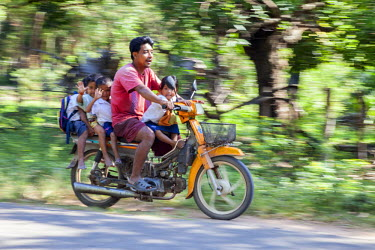 AS40CCE0055 Cambodia. Traffic Safety: Man and Four Children on a Motorbike, no Helmet.