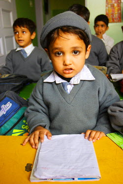 AS28YNI0002 A student in a local school studying in Pakistan