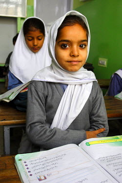 AS28YNI0008 A student in a local school studying in Pakistan