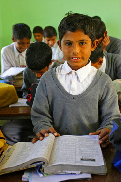 AS28YNI0011 A student in a local school studying in Pakistan