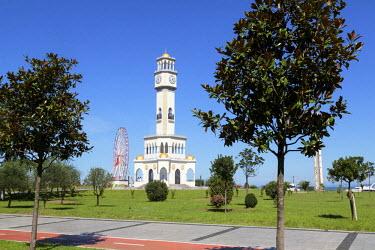 AS08ALA0187 Georgia, Batumi. Clocktower and ferris wheel on the Black Sea coast in Batumi.