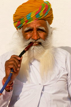 AS10TNO0044 Portrait of man smoking pipe. Mehrangarh Fort. Jodhpur. Rajasthan. India.