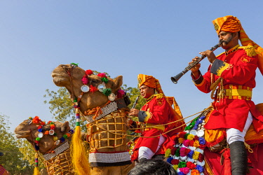 AS10TNO0120 Military on decorated camels. Festival parade. Desert festival. Jaisalmer. Rajasthan. India.