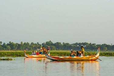 AS06IHO0629 Myanmar. Mandalay. Amarapura. U-Bein Bridge. Boats in the lake.