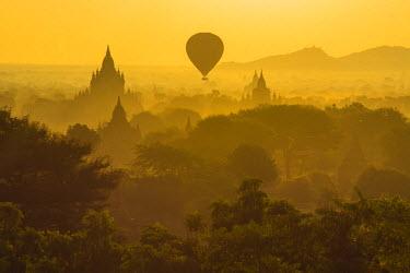 AS06IHO0652 Myanmar. Bagan. Hot air balloons rising over the temples of Bagan.