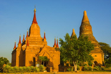 AS06IHO0662 Myanmar. Bagan. Red brick temple glows in the late afternoon light.
