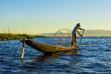 AS06IHO0701 Myanmar. Shan State. Inle Lake. Intha fisherman fishing in the shallows.