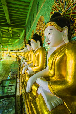 AS06IHO0882 Myanmar. Mandalay. Sagaing Hill. U min Thounzeh (Thirty Caves) temple. Row of Buddhas line the wall.