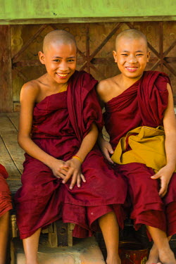 AS06IHO0965 Myanmar. Mandalay. Sagaing Hill. Aung Myae Oo Monastic Education School. Young Buddhist monks socialize before school.