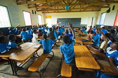 AF25AAS0144 Malawi, Lilongwe, Chambwe Primary School, Ndawona Kawaza teaching her class arithmetic. UNICEF'S Kids-In-Need of Desks project has provided 420 desks. Malawi has failed to attract teachers due to shor...