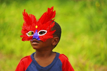 CA13AAS0013 Dominica, Carib Territory, portrait of boy disguised with colorful mask