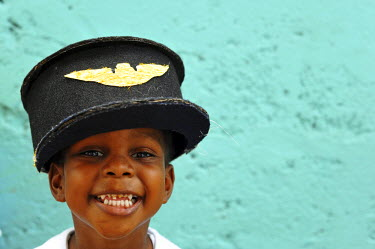 CA13AAS0037 Dominica, Roseau, Preschool CCF, portrait of smiling young boy with marine's hat with bad teeth
