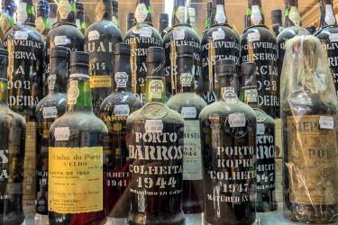 EU23JEN0078 Portugal, Lisbon, expensive port wine bottles in store window