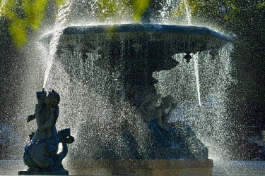 POR8618AW Fountain dating back to 1889, in the centre of the Praca Dom Pedro IV, with mythological statues. Rossio. Lisbon, Portugal
