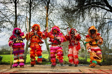 POR8681AW A group of Caretos dancing during the Winter Solstice Festivities. Salsas, Tras-os-Montes. Portugal