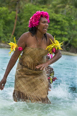 OC07CMI0039 Republic of Vanuatu, Torres Islands, Loh Island. Special performance by the Unique Water Music Women from Gaua. Women dancing in water making music by cupping their hands and splashing.