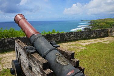 OC09CMI0103 US Territory of Guam, Umatac. Historic Spanish Fort Nuestra Senora de la Soledad (aka Fort Soledad), built in 1800s. Spanish cannon with the Philippine Sea in the distance.