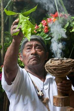 SA13CCE0265 Tres Reyes Maya Community, Riviera Maya, Yucatan, Mexico. Maya Shaman Conducting Religious Ceremony.