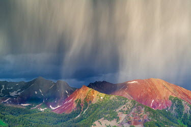 US06HGA0015 Virga and storm moving over mountains near Crested Butte, Colorado