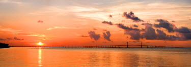 US10SHA0066 A peaceful sunrise scene of the Tampa Bay and Skyway Bridge in Florida