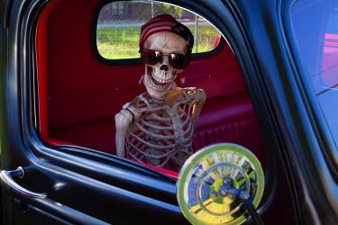 US11JWL0960 USA, Georgia, Savannah, Skeleton character in car show.