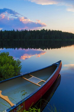 US20JMO1411 A canoe on Little Berry Pond in Maine's Northern Forest. Sunset. Cold Stream watershed, Johnson Mountain Township. Maine, USA