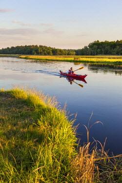 US22JMO0678 A man kayaking on the North River in Marshfield, Massachusetts. Near Emilson Farm. (MR) USA