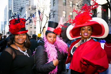 US33JMR0406 New York City, NY, USA. Black women sporting their fashionable hats at the Easter Parade down 5th Avenue.