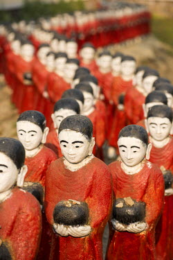 MYA1968AW Rakhine state, Myanmar. Monks statues lined up in a pagoda.