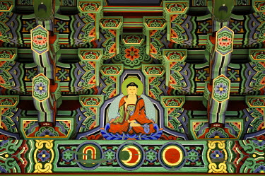 HMS2102915 South Korea, South Gyeongsang Province (Gyeongsangnam-do), Gayasan, detail of a colourful wooden roof and painting of Buddha at the buddhist temple of Haeinsa listed as World Heritage by UNESCO