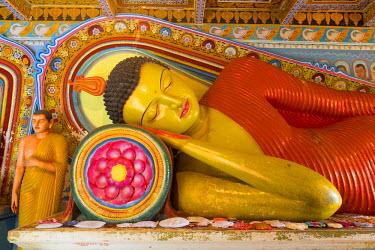 HMS1840497 Sri Lanka, North Central province, Anuradhapura district, Anuradhapura, sacred city listed as World Heritage by UNESCO, Isurumuniya Vihara, reclining Buddha statue