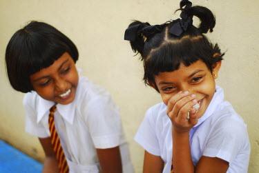 HMS2015042 Sri Lanka, Colombo, portrait of 2 smiling schoolgirls