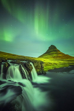 CLKFV36185 Long exposure landscape with waterfalls and aurora borealis above Kirkjufell Mountain, Snaefellsnes peninsula, Western Iceland, Europe.