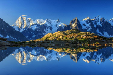 CLKRM37801 Snowy peaks of Dent Du Geant and Grandes Jorasses are reflected in Lac Blanc, Haute Savoie, France, Europe