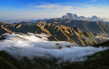 ETH2942 Ethiopia, Amhara Region, Simien Mountains.  Rugged peaks of the Simien Mountains. Distant Mount Ras Dashan rises to 4550m above sea level.