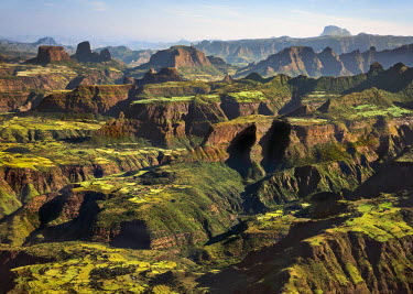 ETH2945 Ethiopia, Amhara Region, Simien Mountains.  Despite the rugged terrain in the Simien Mountains, a large population lives there, cultivating every available space of flat land. Distant Mount Ras Dashan...