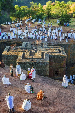 ETH2992 Ethiopia, Amhara Region, Lasta, Lalibela. At sunrise, worshippers attend an early morning outside service at the famous ancient rock-hewn Church of Saint George.