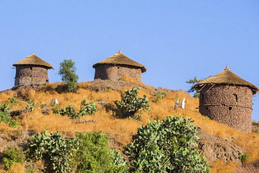 ETH2999 Ethiopia, Amhara Region, Lasta, Lalibela. Traditional double-storied thatched round houses, known as tukuls.  Only in Lasta Province were stone houses built on two floors. This style is no longer in f...
