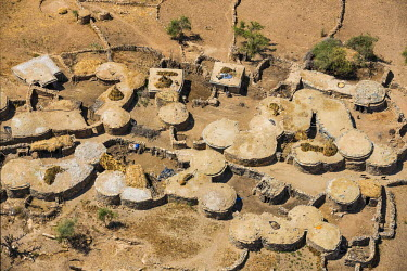 ETH3008 Ethiopia, Tigray Region, Gheralta.  Typical Tigrayan homesteads whose dwelling houses have stone walls and flat, earth-covered roofs. Crops are often dried or stored on these roofs or on those of the...