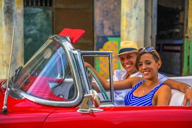 CB01768 Cuba, Havana, La Habana Vieja, Tourists enjoying 1950's classic American Buick (MR)