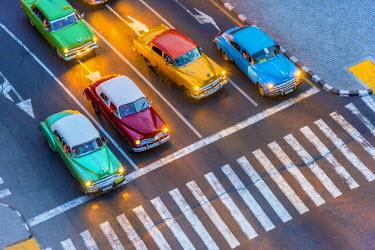 CB01810 Cuba, Havana, Centro Habana, Prado or Paseo de Marti, classic 1950's American cars waiting at pedestrian crossing