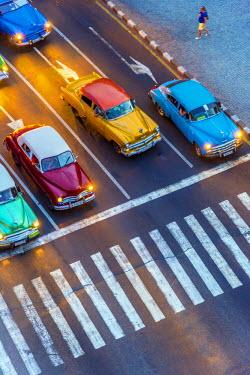 CB01811 Cuba, Havana, Centro Habana, Prado or Paseo de Marti, classic 1950's American cars waiting at pedestrian crossing