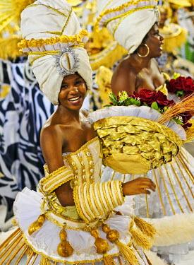 BRA2907AW Brazil, State of Rio de Janeiro, City of Rio de Janeiro, Samba Dancer in the Carnival Parade at The Sambadrome Marques de Sapucai.